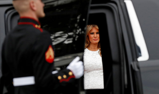 U.S. first lady Melania Trump is seen through the car doors as she and President Donald Trump greet Japanese Prime Minister Shinzo Abe and his wife Akie Abe as they arrive for dinner at the White House in Washington, U.S., April 26, 2019. (Photo by Kevin Lamarque/Reuters)