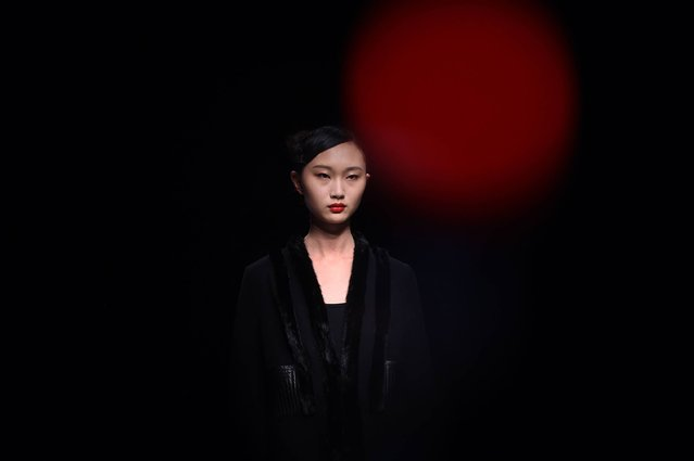 A model parades a creation from the POLY BRIGHT Wang Fei Collection show during China Fashion Week in Beijing on March 25, 2016. (Photo by Wang Zhao/AFP Photo)