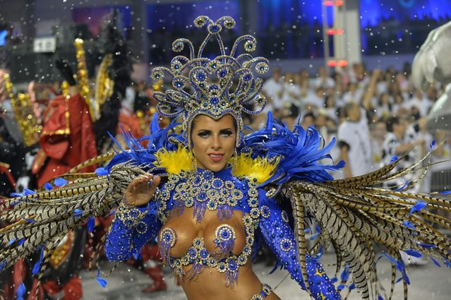 A reveler of the Gavioes da Fiel samba school performs during the second night of carnival parade at the Sambadrome in Sao Paulo, Brazil on March 1, 2014. Gavioes da Fiel's theme for this year's carnival is an homage to Brazilian former football star Ronaldo. (Photo by Nelson Almeida/AFP Photo)