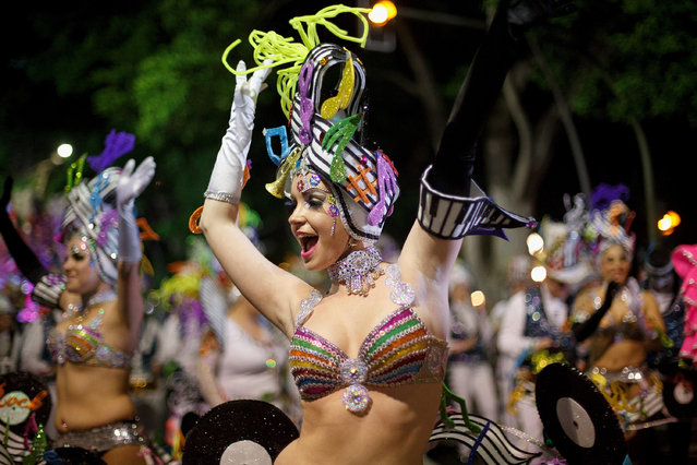 Members of 'Los Rumberos' troupe perform in the troupes dancing contest during the Santa Cruz de Tenerife Carnival on March 1, 2014 in Santa Cruz de Tenerife on the Canary island of Tenerife, Spain. (Photo by Pablo Blazquez Dominguez/Getty Images)