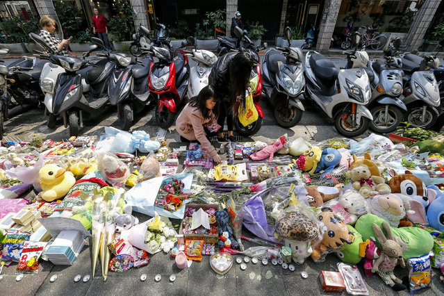 People offer flowers and prayers for a four-year-old child victim of a random killing, at a makeshift memorial at a street next to the crime scene, in Taipei, Taiwan, 29 March 2016. The brutal beheading of a child on a sidewalk next to her mother in broad daylight on 28 March has reinforced the fight in favor of capital punishment in Taiwan and weakened the movement advocating the abolition of death penalty on the island. An amendment was also presented favoring automatic death sentences for such offences, and protests in favor of harsher punishment have led those opposing capital punishment to avoid a clear defense of their position, which never really enjoyed popular support. (Photo by Ritchie B. Tongo/EPA)