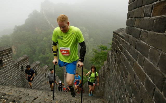 Michael-Robbert Brans of the Netherlands takes part in the Great Wall Half Marathon at the Huangyaguan Great Wall outside Beijing, China, May 18, 2019. (Photo by Thomas Peter/Reuters)