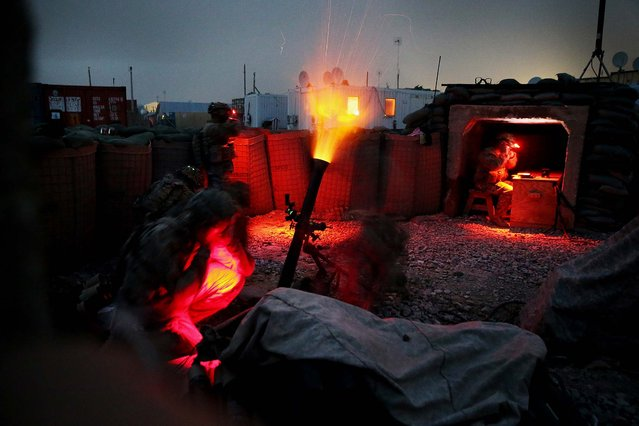 Soldiers with the U.S. Army's 3rd Brigade Combat Team, 10th Mountain Division fire a mortar round during a training exercise on FOB Lightning near Gardez, Afghanistan, on March 21, 2014. (Photo by Scott Olson/Getty Images)