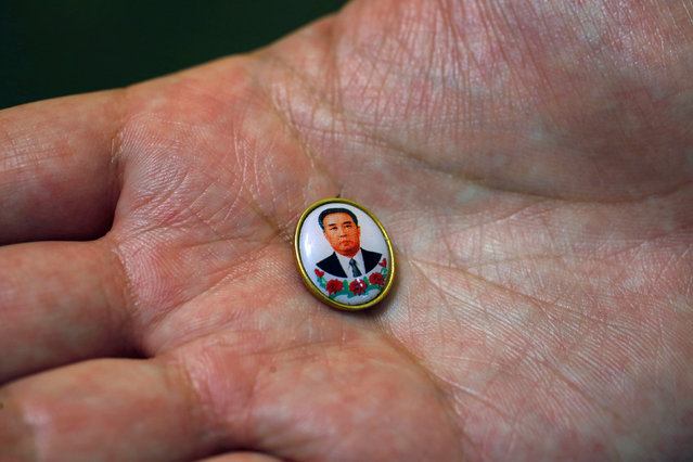 Thomas Hui poses with a pin featuring former North Korean leader Kim Il Sung, the smallest pin he has collected, at his apartment in Hong Kong, China April 11, 2016. (Photo by Bobby Yip/Reuters)