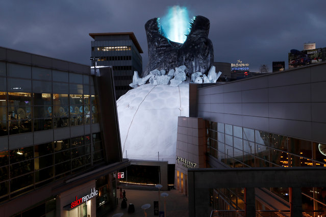 """A prop promoting the film """"Godzilla: King of the Monsters"""" is pictured on the roof of the Cinerama Dome theatre in Los Angeles, California, U.S., June 3, 2019. (Photo by Mario Anzuoni/Reuters)"""