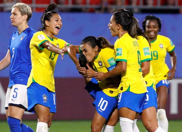 Brazil's forward Marta (C) celebrates after scoring a goal during the France 2019 Women's World Cup Group C football match between Italy and Brazil, on June 18, 2019, at the Hainaut Stadium in Valenciennes, northern France. (Photo by Phil Noble/Reuters)