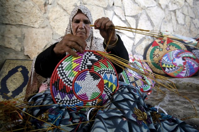 Palestinian woman Nasra Abo Hammad, 75, makes straw trays for sale at her home in West Bank village of Kifl Hares, south of Nablus April 11, 2016. (Photo by Abed Omar Qusini/Reuters)