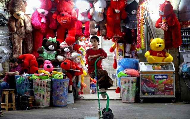 A young worker sits on his hand cart at the old main bazaar in Tehran, Iran, Wednesday, May 8, 2019. After the U.S. withdrew from the the 2015 nuclear deal it restored crippling sanctions on Iran, exacerbating a severe economic crisis. The Iranian rial, which traded at 32,000 to $1 at the time of the accord, traded Wednesday at 153,500. (Photo by Ebrahim Noroozi/AP Photo)