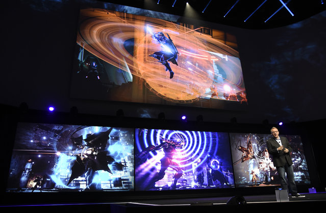 """Adam Boyes, vice president of publisher and developer relations for Sony Computer Entertainment America, discusses the video game """"Destiny: The Taken King"""" at the Sony Playstation at E3 2015 news conference at the Los Angeles Sports Arena on Monday, June 15, 2015, in Los Angeles. (Photo by Chris Pizzello/Invision/AP)"""