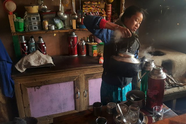 A Nepalese woman prepares tea in a refuge for mountaineers in the Khumbu Valley in the Everest region of Nepal in this picture taken April 14, 2016. (Photo by Antoni Slodkowski/Reuters)