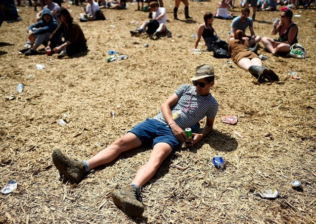 Revellers relax in front of the Other stage at Worthy Farm in Somerset during the Glastonbury Festival in Britain, June 27, 2015. (Photo by Dylan Martinez/Reuters)