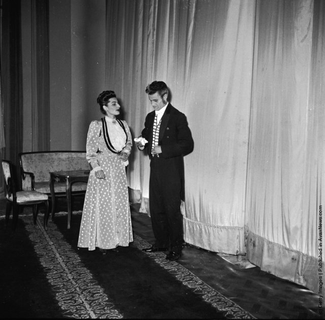 1950: Two actors from a production of Oscar Wilde's play, 'Lady Windemere's Fan' talk back-stage at the Theatre Saadi in Tehran