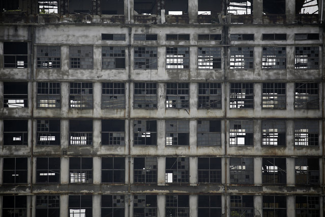 "In this June 29, 2015 photo, a forlorn building is seen at Hashima Island, commonly known as Gunkanjima, which means ""Battleship Island"", off Nagasaki, Nagasaki Prefecture, southern Japan. (Photo by Eugene Hoshiko/AP Photo)"