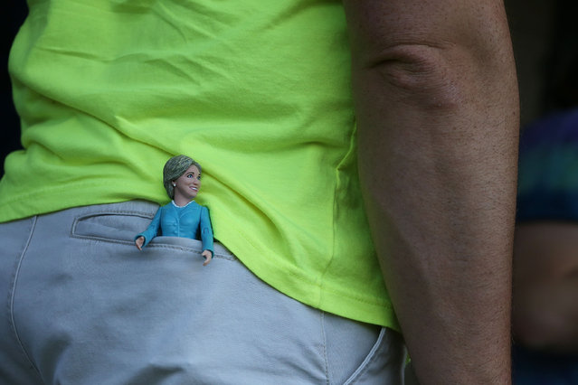 A doll of Democratic presidential candidate Hillary Clinton is seen in the back pocket of a person as he waits for her to make a campaign stop at the Douglass Park Gynasium on May 1, 2016 in Indianapolis, Indiana. Presidential candidates continue to campaign across the state leading up to Indiana's primary day on May 3. (Photo by Joe Raedle/Getty Images)