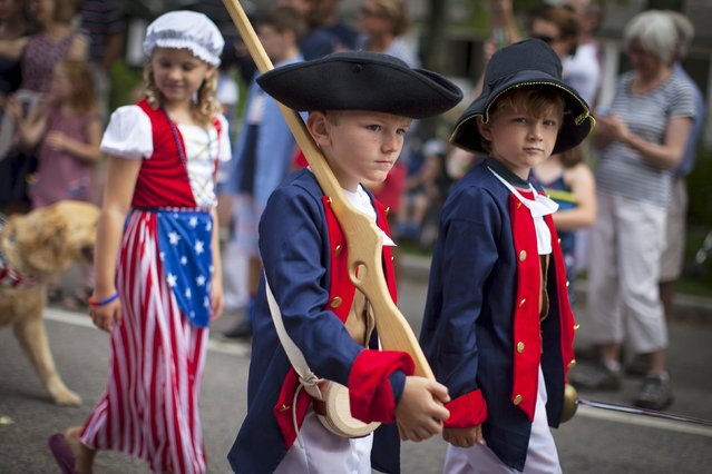 Children in revolutionary war era costumes march through Barnstable Village on Cape Cod, during the annual Fourth of July Parade celebrating the country's Independence Day, in Barnstable, Massachusetts, July 4, 2015. (Photo by Mike Segar/Reuters)