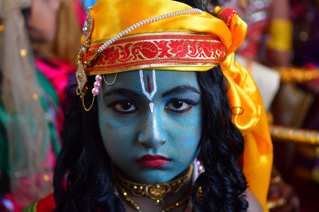 A girl dresses up as the Hindu deity Krishna to celebrate Janmashtami, his birthday in Agartala, India on August 26, 2019. (Photo by Abhisek Saha/Barcroft Media)