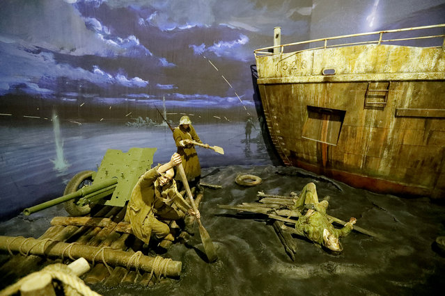 """A scene showing Soviet soldiers """"Crossing the Dnieper River"""" during World War II is prepared for the opening of the 3D Panorama exhibition """"Memory talks. The road through war"""" in the former Sevcabel port in St. Petersburg, Russia, 16 September 2019. (Photo by Anatoly Maltsev/EPA/EFE)"""