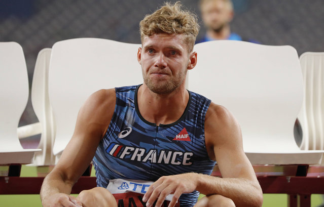 Kevin Mayer, of France, sits on a bench after pulling out of the the men's decathlon pole vault competition because of an injury at the World Athletics Championships in Doha, Qatar, Thursday, October 3, 2019. (Photo by Hassan Ammar/AP Photo)