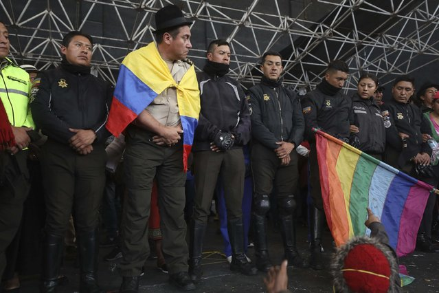 Police detained by anti-governments protesters are presented on a stage in Quito, Ecuador, Thursday, October 10, 2019. Thousands of protesters staged anti-government rallies Wednesday, seeking to intensify pressure on Ecuador's president after a week of unrest sparked by fuel price hikes. (Photo by Fernando Vergara/AP Photo)