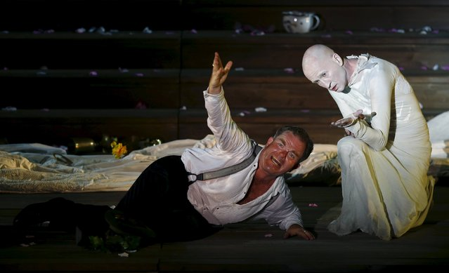 """Actors Cornelius Obonya as Jedermann (L) and Peter Lohmeyer as Tod perform on stage during a dress rehearsal of Hugo von Hofmannsthal's drama """"Jedermann"""" (Everyman) at Domplatz square in Salzburg, Austria, July 16, 2015. (Photo by Leonhard Foeger/Reuters)"""