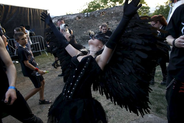 A participant of the Castle Party festival dances during concert at castle in Bolkow, southwestern Poland, July 17, 2015. (Photo by Kacper Pempel/Reuters)