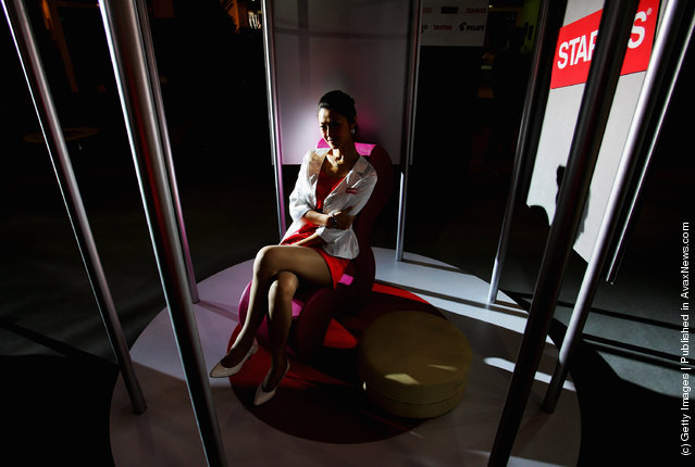 A Chinese model promotes a company's products at the 10th China International Furniture Exhibition