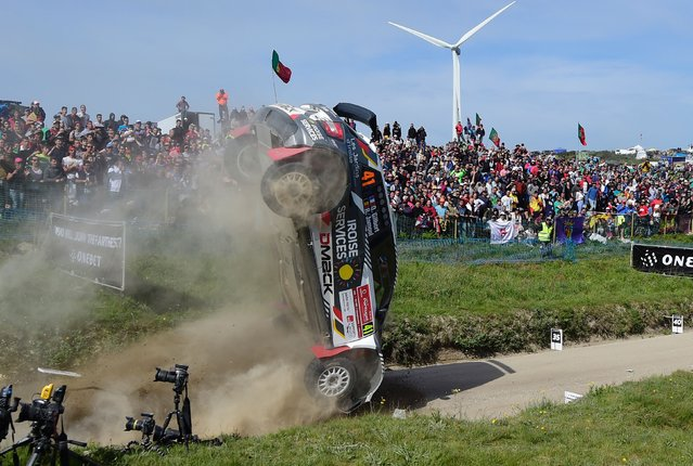 French driver Quentin Gilbert and co-driver Belgian Renaud Jamoul, crash their Skoda Fabia RS in Fafe, northern Portugal, on May 21, 2017, during the SS16 stage of the Portuguese WCR rally. (Photo by Miguel Riopa/AFP Photo)