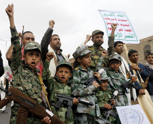 Boys join Houthi followers as they demonstrate against Saudi-led air strikes in Yemen's capital Sanaa July 24, 2015. A Saudi-led coalition of Arab states has been bombing the Iranian-allied Houthi rebel movement and army forces loyal to former Yemeni president Ali Abdullah Saleh since late March in a bid to restore exiled President Abd-Rabbu Mansour Hadi to power. (Photo by Khaled Abdullah/Reuters)