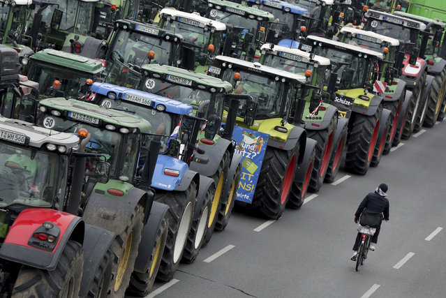 Farmers have parked their tractors on a road between the university and the Brandenburg Gate in Berlin, Germany, Tuesday, November 26, 2019. Some thousands farmers are expected in the German capital for a protest rally against the German and European agriculture policy. (Photo by Michael Sohn/AP Photo)