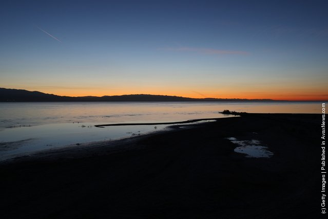 The Salton Sea is seen before dawn in an area where a controversial development would create a new town for nearly 40,000 people on the northwest shore of the biggest lake in California, the Salton Sea