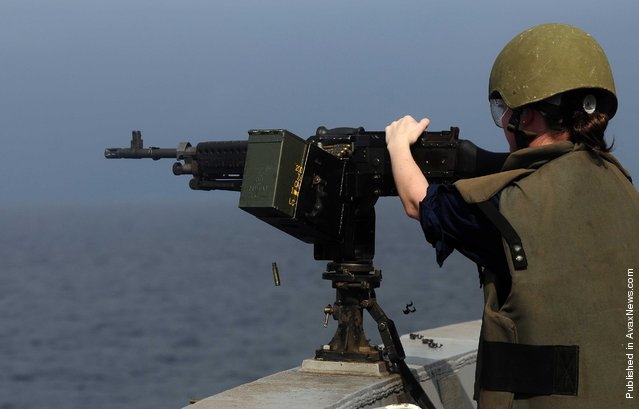 Information Systems Technician 2nd Class Elise Hicks participates in a live-fire training exercise aboard the San Antonio-class amphibious transport dock ship USS Mesa Verde (LPD 19)