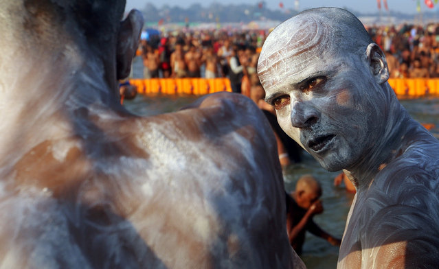 "A Naga sadhu or a Hindu holy man stands after taking a dip during the third ""Shahi Snan"" (grand bath) at ""Kumbh Mela"" or the Pitcher Festival, in Prayagraj, previously known as Allahabad, India, February 10, 2019. (Photo by Jitendra Prakash/Reuters)"