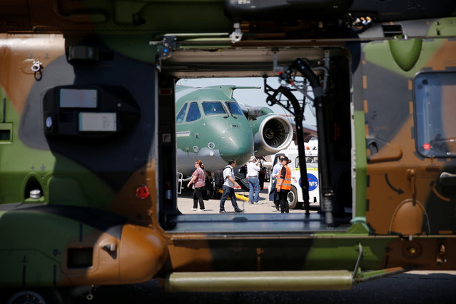 A Embraer KC-390, a medium-size, twin-engine jet-powered military transport aircraft is seen through the door of a NH90 helicopter at the 52nd Paris Air Show at Le Bourget Airport near Paris on June 20, 2017. (Photo by Pascal Rossignol/Reuters)