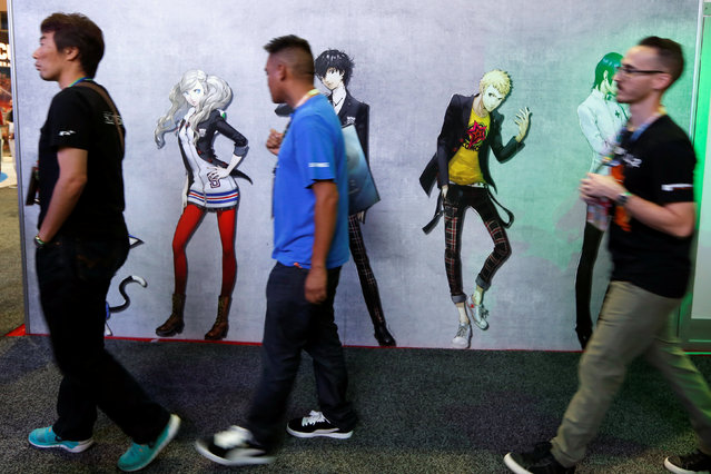 Attendees walk past video game characters at the E3 Electronic Expo in Los Angeles, California, U.S. June 14, 2016. (Photo by Lucy Nicholson/Reuters)