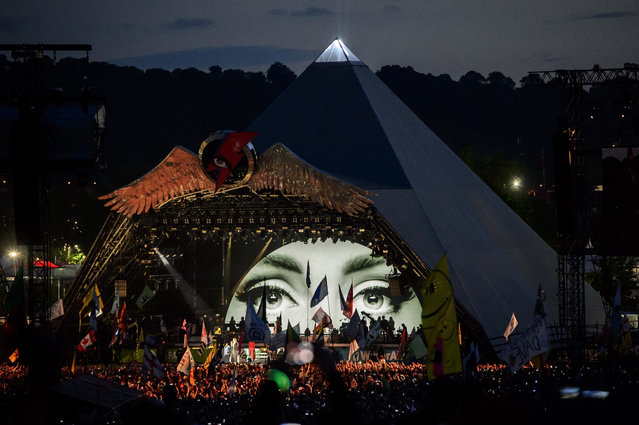 British singer Adele performs at the Glastonbury music festival at Worthy Farm, in Somerset, England, Saturday, June 25, 2016. (Photo by Jonathan Short/Invision/AP Photo)