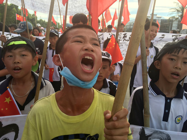 Villagers including schoolchildren take part in a protest march, demanding the release of their village chief Lin Zuluan, in Wukan, in China's Guangdong province June 21, 2016. (Photo by James Pomfret/Reuters)