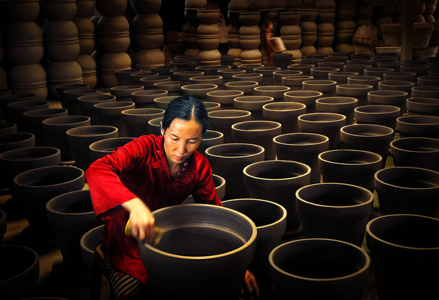 CGAP Photo Contest – Production of Ceramic, Vietnam. This woman was able to establish this small craft workshop through the government's financial assistance. (Photo by Van Bang Vo)