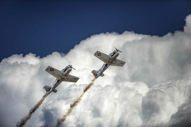 The Trojan Phlyers Air Race & Airshow Team perform in their restored T-28B aircraft at the Colorado Springs Airport for the Pikes Peak Regional Air Show, on August 9, 2014. (Photo by Michael Ciaglo/The Colorado Springs Gazette)