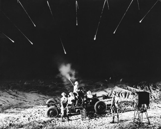 Firing at night, this gun crew from the First Composite Antiaircraft Battery, British Army, made this remarkable picture of eight tracers caught in flight  August 28, 1943. Note the still smoking gun. (Photo by Sgt. Hugh Morton/AP Photo)