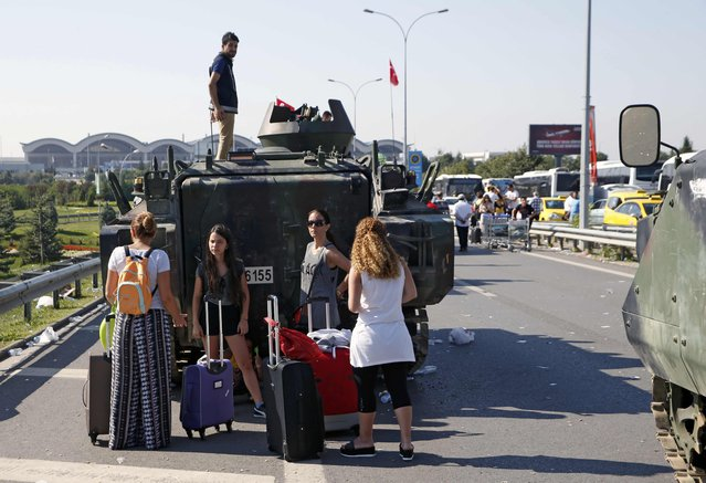 Women stand behind a military vehicle in front of Sabiha Airport, in Istanbul, Turkey July 16, 2016. (Photo by Baz Ratner/Reuters)