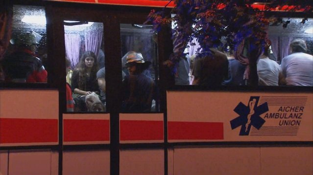 A screen grab taken from video footage shows people being evacuated onto a bus following a shooting rampage at the Olympia shopping mall in Munich, Germany July 22, 2016. (Photo by Reuters/Reuters TV)