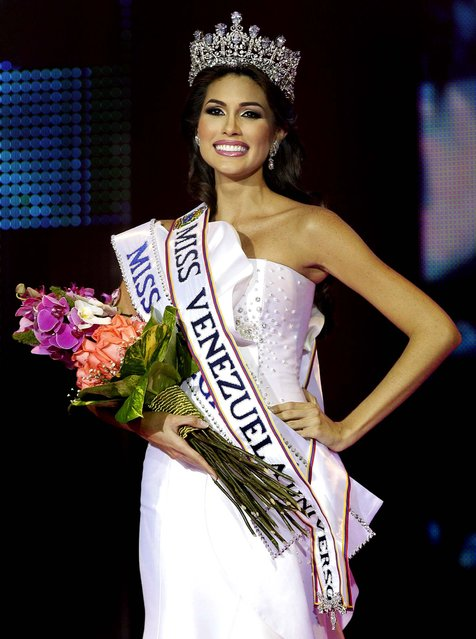 Maria Gabriela Isler smiles after being crowned Miss Venezuela 2012 on August 30, 2012. (Photo by Ariana Cubillos/Associated Press)
