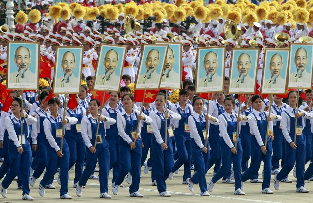 Workers carry portraits of late Vietnamese revolutionary leader Ho Chi Minh during a parade marking their 70th National Day at Ba Dinh square in Hanoi, Vietnam September 2, 2015. (Photo by Reuters/Kham)