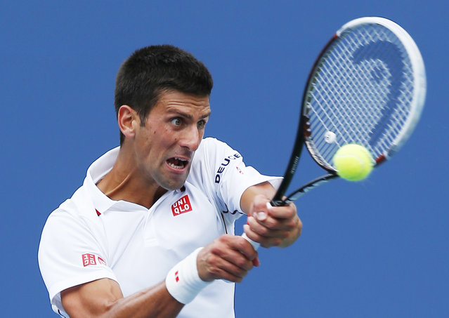 Novak Djokovic, of Serbia, returns a shot against Sam Querrey, of the United States, during the third round of the 2014 U.S. Open tennis tournament, Saturday, August 30, 2014, in New York. (Photo by Matt Rourke/AP Photo)