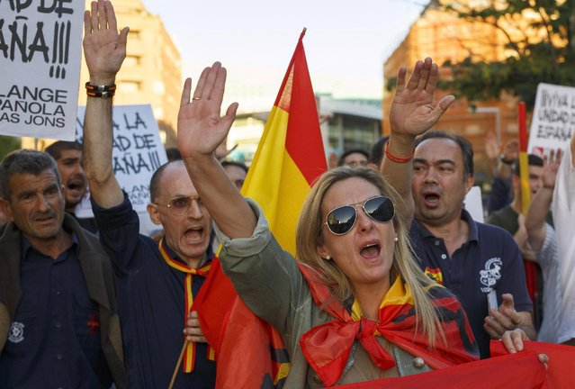 Demonstrators do the fascist salute during a protest against the independence of Catalonia under the slogan 'For the unity of Spain' called by far right wing party Falange Espaola de las Jons at Salvador Dali Square on October 7, 2017 in Madrid, Spain. Tension between the central government and the Catalan region have increased after last weekend's independence referendum. The Spanish government suspended the Catalan parliamentary session planned for Monday in which a declaration of independence was expected to be made. (Photo by Pablo Blazquez Dominguez/Getty Images)