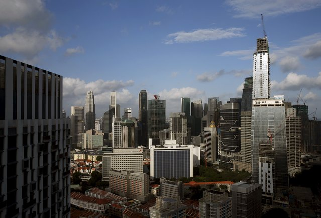 GuocoLand Ltd's mixed-use Tanjong Pagar Centre (R), soon to be the tallest building in the city-state, towers over other buildings in the central business district of Singapore February 29, 2016. (Photo by Edgar Su/Reuters)