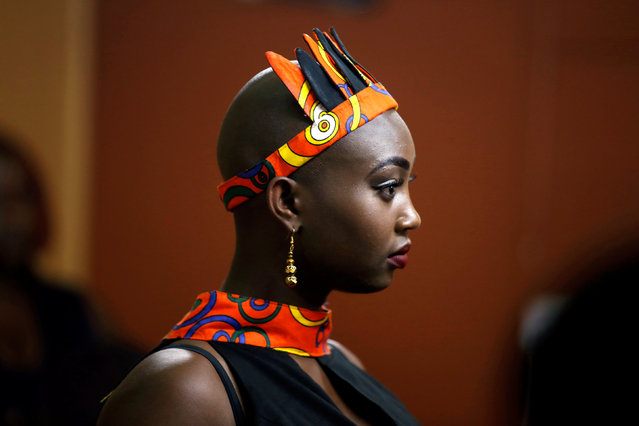 A model waits back stage before participating in a plus size fashion show in Nairobi, Kenya, October 7, 2017. (Photo by Baz Ratner/Reuters)