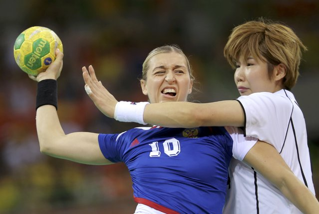 2016 Rio Olympics, Handball, Preliminary, Women's Preliminary Group B Russia vs South Korea, Future Arena, Rio de Janeiro, Brazil on August 6, 2016. Olga Akopian (RUS) of Russia abd Kim Jin-Yi (KOR) of South Korea in action. (Photo by Marko Djurica/Reuters)