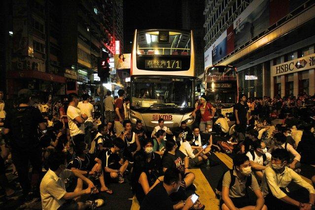 Hundreds of protesters block traffic on Nathan Road at Hong Kong's shopping Mongkok district September 29, 2014. (Photo by Liau Chung-ren/Reuters)