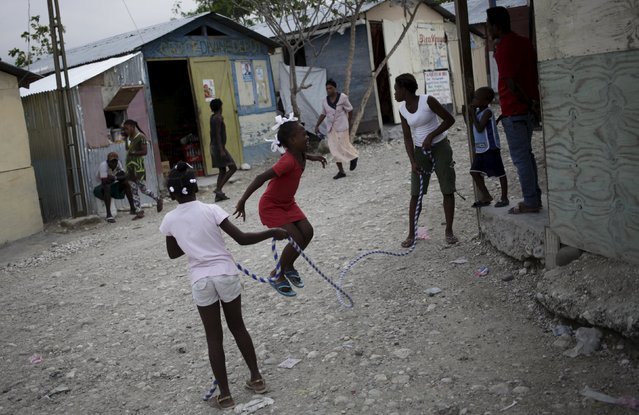 Girls play at a camp for displaced people in Port-au-Prince, Haiti, March 6, 2016. (Photo by Andres Martinez Casares/Reuters)